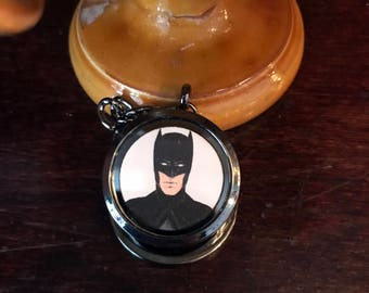 Batman/Bruce Wayne Magnetic Keychain Locket. Open locket to unmask the Batman!