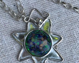 Delightful sterling silver Starburst pendant accented with sterling silver balls. The center is a gorgeous, unique circular Opal cabochon.