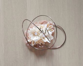 Ring bearer with satin flowers and aluminum wire