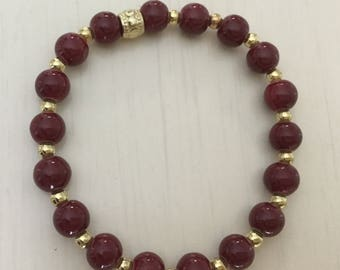 Bracelet  glass opaque beads, red, gold color, spacer balls, stretchy