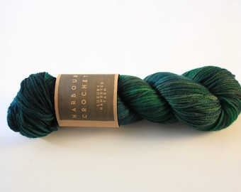 Corvid - Luxury Superwash Squashy Merino DK Yarn by Harbour Crochet. 100g/225m skein. Handdyed / kettle dyed; black/green/teal