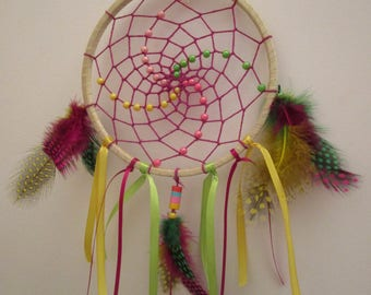Dream catcher handmade purple, yellow and green, decorated with ribbons and feathers