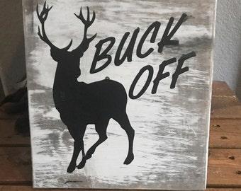 Buck Off sign