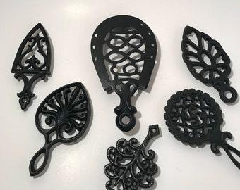 Vintage cast iron trivets