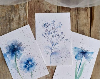 Three postcards with blue flowers