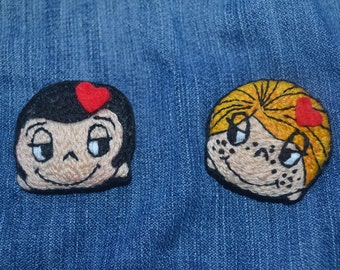 Couple embroidered brooches
