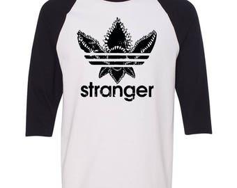 Stranger - Adidas Demogorgon Ralgan Baseball T-Shirt. Stranger Raglan Baseball Tee. S-2XL.