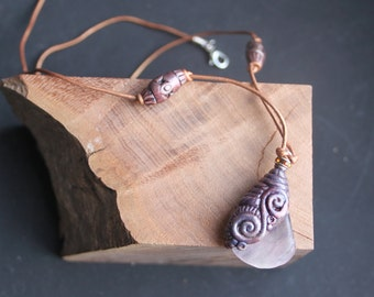 tribal necklace of polymer clay and light pink fluorite