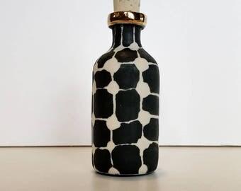 tiny cork-stoppered porcelain bottle with silkscreened underglaze pattern