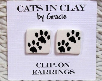 Dog Or Cat Paw Prints Clip On Earrings Handmade In Kiln Fired Clay by Grace M Smith