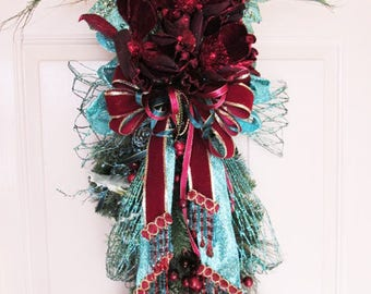 Turquoise and Burgundy Magnolia Peacock Feather Holiday Vertical Door Swag
