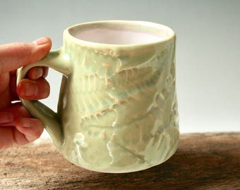 Pale green mug with Fishbone Fern design