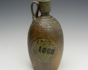 Salt/soda fired bottle with slip decoration