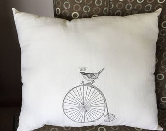Accent pillow- bird on a bicycle