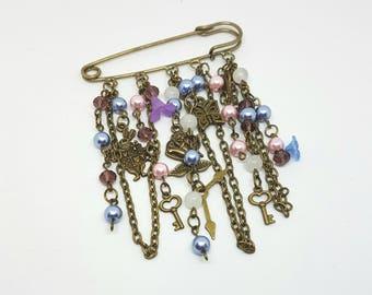 Alice in wonderland vintage style charms beaded brooch