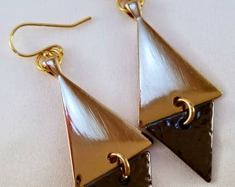 Gold and black geometric dangle earrings.