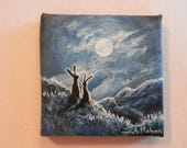 "Original painting: ""Moon struck"", two hares gaze at the moon while beyond them a track winds away across the fells, hand painted mini canvas"