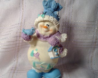 Lightweight Ceramic Snowman Figurine - Light Blue, Purple, & Green - Bundled Up, Holding Bird - Winter Scenery on Belly - Christmas Decor