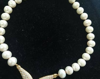 Knotted pearl necklace with gold filled crown piece