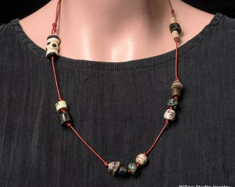 Red Sky, rustic ceramic and glass art beads knotted onto red pearlescent leather become a petite necklace, many ways to wear