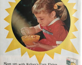 Sweet 1957 ad for Kellogg's Corn Flakes...Sun up with Kellogg's.