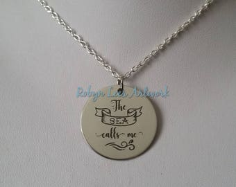 The Sea Calls Me Engraved Stainless Steel Disc Necklace on Silver Crossed Chain or Black Faux Suede Cord