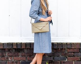 envelope clutch with strap & gold crossbody bag