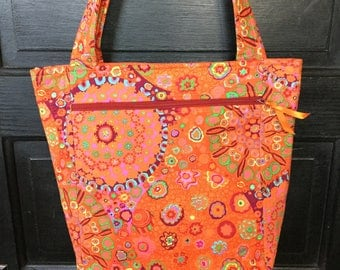 Orange fun patterned shoulder bag/purse with 5 pockets and two straps
