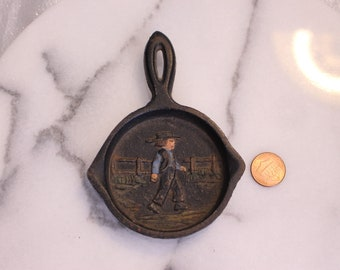 Vintage Miniature Cast Iron Black Fry Pan Skillet with Man Walking Signed by York Pena II