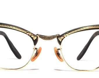 Vintage eyewear. Bausch&Lomb 1950's. Art Deco style. Gold filled. Stunning gold artistic detailing. High quality very good condition. Lovely