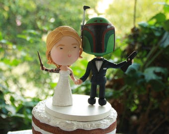 Witch and Bounty Hunter holding hands. Themed cake topper. Wedding figurine.  Handmade. Fully customization.