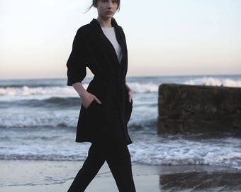 Black leisure suit. Two-piece suit: trousers + cardigan.