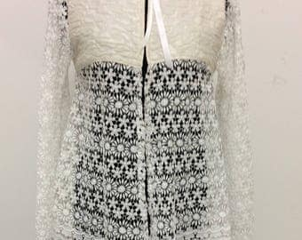 Beautiful 60s inspired lace jacket.