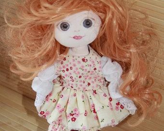 Textile doll handmade interior toy doll textile doll handmade from mixed materials.