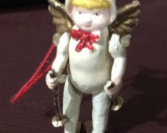 Vintage miniature angel on snow skis with movable arms and legs