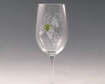 "Grapes White Wine Glass - Permanently frosted grapevine design with bright green Swarovski crystal ""grapes""."