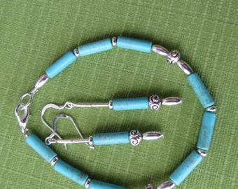 Chinese turquoise bracelet with silver beads and matching earrings.