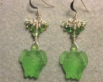 Light green sea glass sea turtle bead earrings adorned with light green Czech glass beads and tiny dangling light green Czech glass beads.