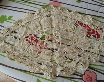 the spindle in antique linen doily