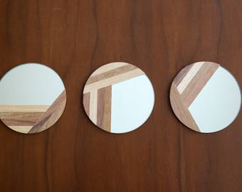 3 small marquetry mirrors