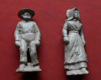 Vintage solid Cast Iron Amish old man and woman couple figures.