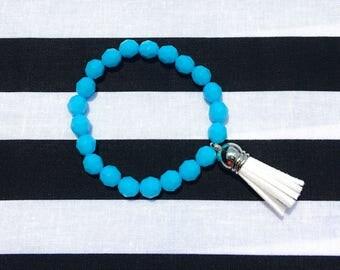 Blue beaded bracelet with white tassel