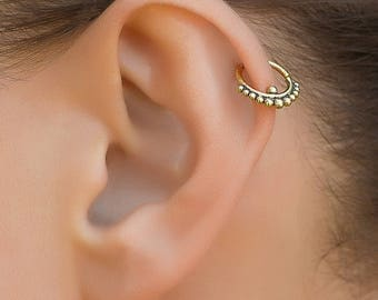 Tribal tragus earring. tragus hoop. tiny hoop earrings. gold helix earring. tiny earrings. helix earring. daith earring