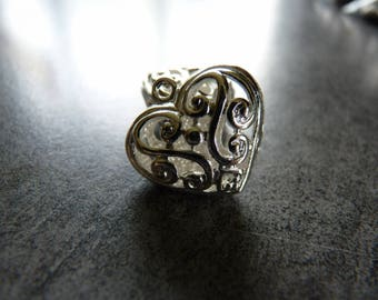 Decorated with silver heart filigree