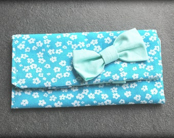 clutch pin has light blue flower printed cotton bow
