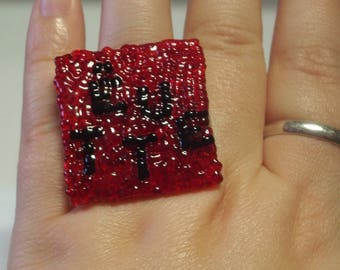 "ring square message ""stubborn"" mosaic of red and black beads"