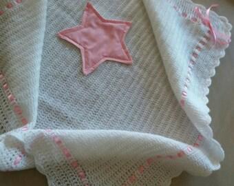 White crochet baby crib blanket