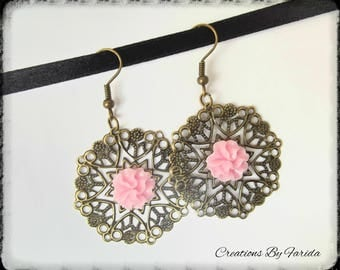Bronze earrings with a pink flower