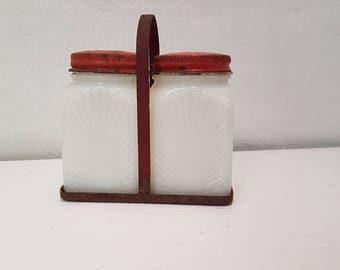 Milk glass salt and pepper in caddy