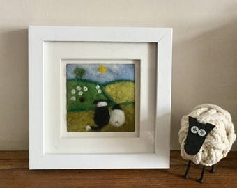 Sheep and Border Collie needle felted fibre art picture. 'Watching the Flock' Shows a sheep and sheepdog looking across the fields at sheep